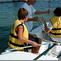 Organisation of two types of summer camps: sailing and sailing with English classes