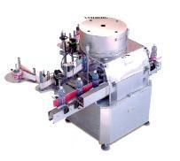 Automatic rotary self-adhesive labeller