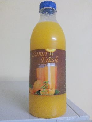 Juice of orange with his flesh 100 % native